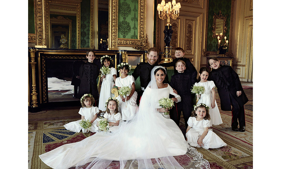 In the Duke and Duchess of Sussex's official wedding portraits, Princess Charlotte and Prince George showed off their sibling similarities with nearly identical smiles.