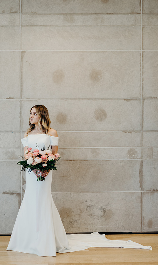 Lauren made the most beautiful bride, holding her bouquet created by Crown Flora and keeping her blond locks curled naturally by her shoulders, as styled by Toronto's Tony Pham.
