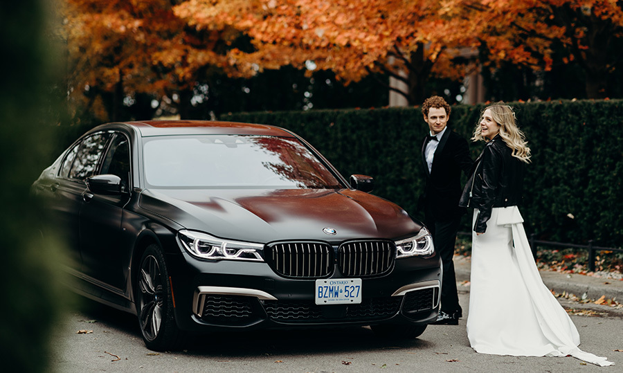 The couple was driven to and from their venue in a sleek black BMW.