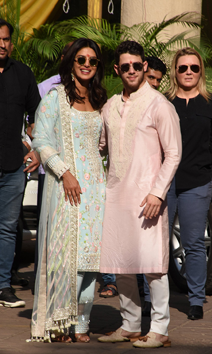 The nearly newlyweds kicked off their wedding celebrations with a puja – a religious act of devotion – at Priyanka's Mumbai home. Nick wore traditional Indian dress, a pink kurta, for the pre-wedding party, while his wife-to-be looked stunning in an embroidered sari. 