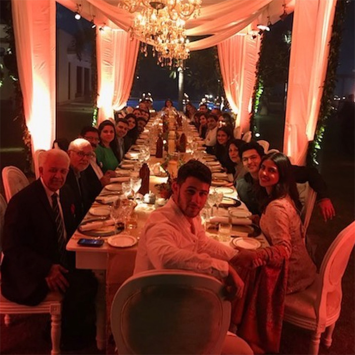 Before the wedding festivities began, Nick joined Priyanka's family in India to celebrate American Thanksgiving. Seated at a stunning table with beautiful chandeliers overhead, the large family smiled for a holiday snap.