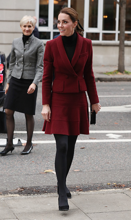 Kate dazzled in a berry skirt suit by Paule Ka for a visit to University College London. She debuted a new hairstyle for her – a ponytail held high with a pretty ribbon!