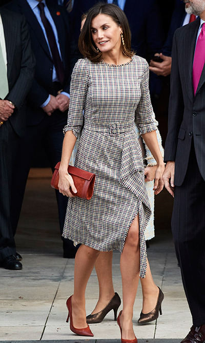 Letizia looked trendy in tweed for a visit to Madrid's Prado Museum! The stunning ensemble was crafted by Pedro del Hierro, and she paired the look with red accessories.