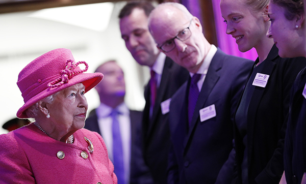 The Queen loves her bright colours, so it was no surprise she donned a gorgeous pink double-breasted coat by Stewart Parvin, with a matching hat by Rachel Trevor Morgan, for an outing to the Royal Institute of Chartered Surveyors.
