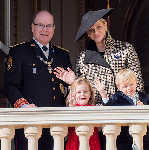 For Monaco's National Day, Princess Charlene looked elegant as ever in a patterned coat, Dior pearl earrings and an elegant black saucer hat.