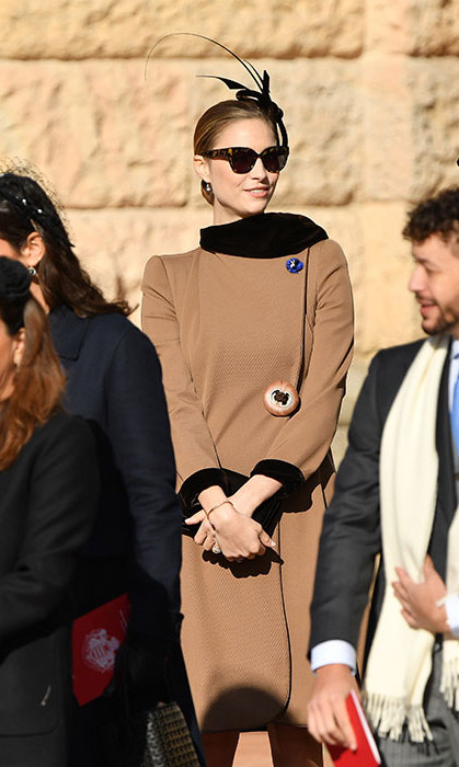 Beatrice Borromeo is crazy for camel! Pierre Casiraghi's wife wore the chic coat with a black fascinator and shades for Monaco's celebrations.