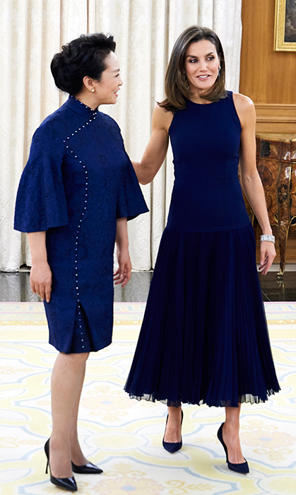 The royal ladies matched in navy blue, with Letizia wearing an elegant Felipe Varela midi dress.