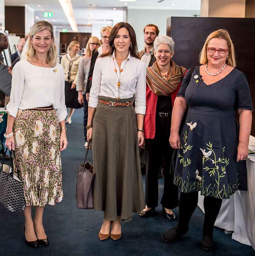 Crown Princess Mary looked perfectly casual in a brown belted skirt and blouse combo.