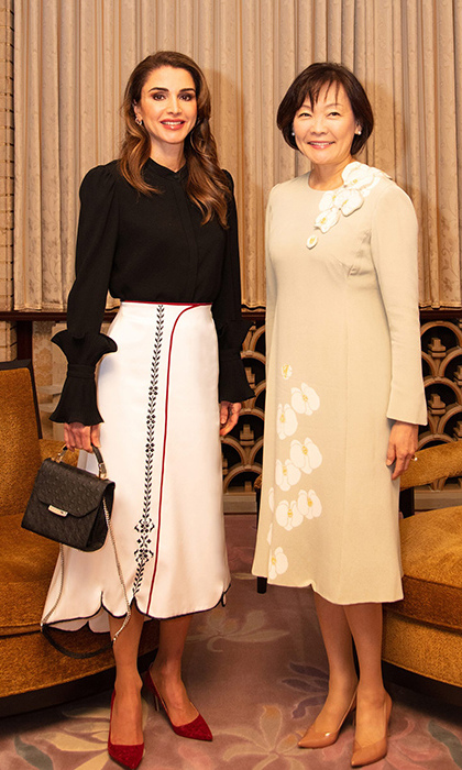 Ever the fashion maven, Queen Rania of Jordan nailed this look in a hand-embroidered skirt by Jordanian designer Suha Khawaja and a handbag by Farah Asmar, another designer from her home country. She was attending a meeting in Tokyo.