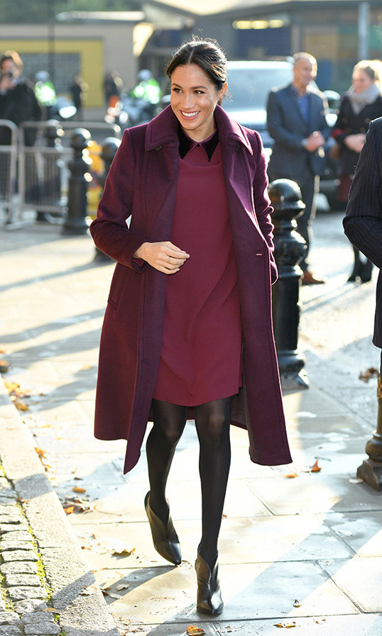 Meghan wore the perfect berry-hued Club Monaco shift dress, complete with a velvet collar, for a visit to the Hubb Community Kitchen in 2018. We love the look for a day party, complete with coordinated coat and leather booties (hers Givenchy), and could see it going from day to night by ditching the coat and throwing on a pair of sequinned pumps!