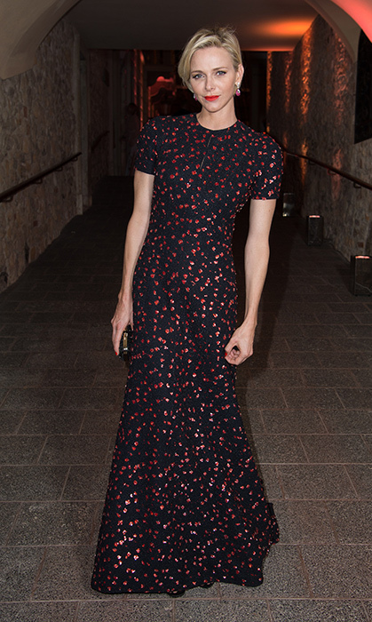At the Princess Grace Awards gala in 2015, the Monegasque royal wore the perfect holiday dress – a beautiful red-and-black Christian Dior design paired with a bright red lip.