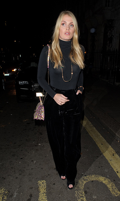 For a more casual holiday ensemble, look no further than Lady Kitty Spencer's velvet pant and turtleneck combo! She wore the look for a Christmas party at Annabel's.