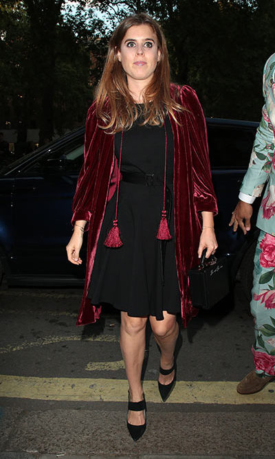 Princess Beatrice spruced up her simple black dress with a crushed-velvet burgundy jacket to attend the Annabel's x Dior dinner in 2018.