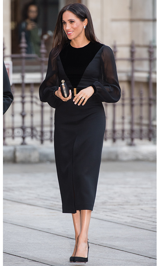 The Duchess of Sussex wore the perfect holiday party dress for a trip to the Royal Academy of Arts in 2018 – a gorgeous mix of velvet and chiffon by Givenchy!