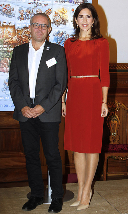 Princess Mary was perfectly polished at a Christmas stamp presentation in Copenhagen in 2018. The mother of four gave her red dress with gathered neckline an extra-festive accent with a metallic gold belt. 