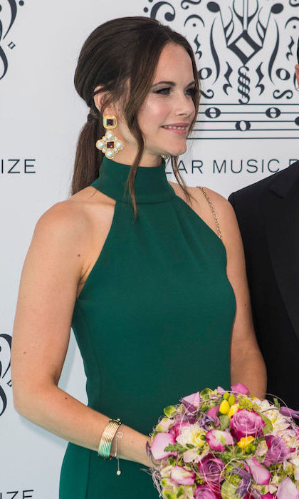 Princess Sofia of Sweden channeled the Duchess of Sussex at the Polar Music Prize in 2018, wearing a green halter gown with a fishtail hemline. The brunette beauty paired the holiday-worthy dress with a pair of statement earrings featuring coloured stones and pearls.