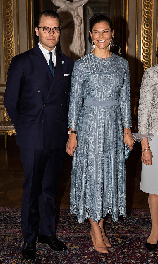 A little metallic never hurts around the holidays! Crown Princess Victoria wore a stunning silver design to welcome the Italian president to Sweden in 2018, featuring a floral design with scalloped edges and a belted waist. She finished the look with a sleek hairstyle and nude pumps.