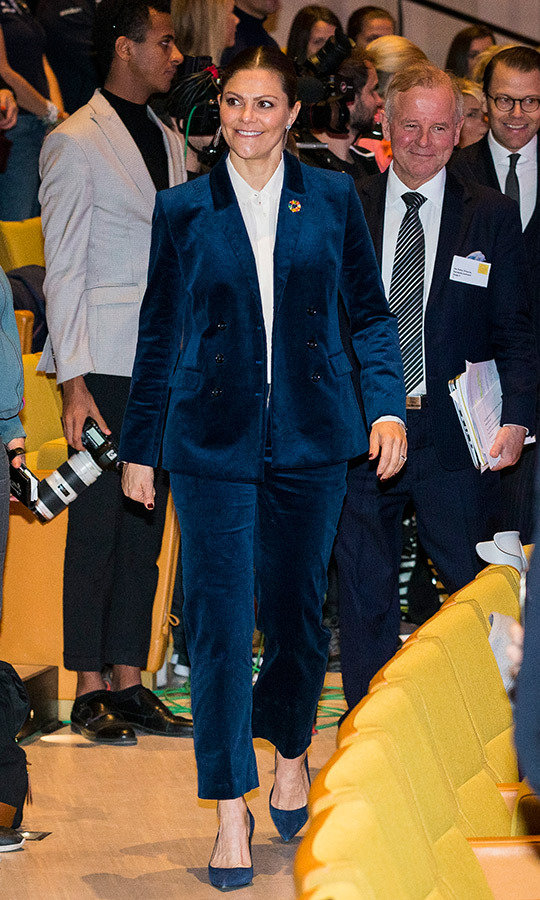 If suiting's more your speed, this blue velvet ensemble - worn by Crown Princess Victoria to the Pep Forum 2018 in Stockholm - will crush it during the holiday season. Pair with a sleek button-up shirt and matching pumps.