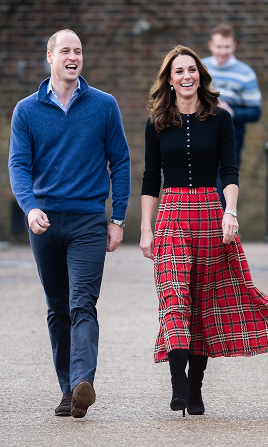 "The <a href=""/tags/0/prince-william/"">Duke</a> and <a href=""/tags/0/kate-middleton/"">Duchess of Cambridge</a> were in high spirits on Tuesday (Dec. 4) as they opened up the Orangery at Kensington Palace for a Christmas party with the families of military personnel stationed in Cyprus. The parents of three were keen to honour the work of servicemen and women who are away from their families over the festive season - and have some fun with their partners and children, from a photo booth that sent snaps directly to Cyprus to Christmas crafts like decorating snow globes and making crackers. Prince William and Kate looked wonderful for the occasion, he in a blue sweater and slacks and she <a href=""https://ca.hellomagazine.com/fashion/02018120448871/kate-middleton-emilia-wickstead-tartan-skirt-christmas-party""><strong>in a plaid skirt by one of her go-to designers</strong></a> with black accessories. 