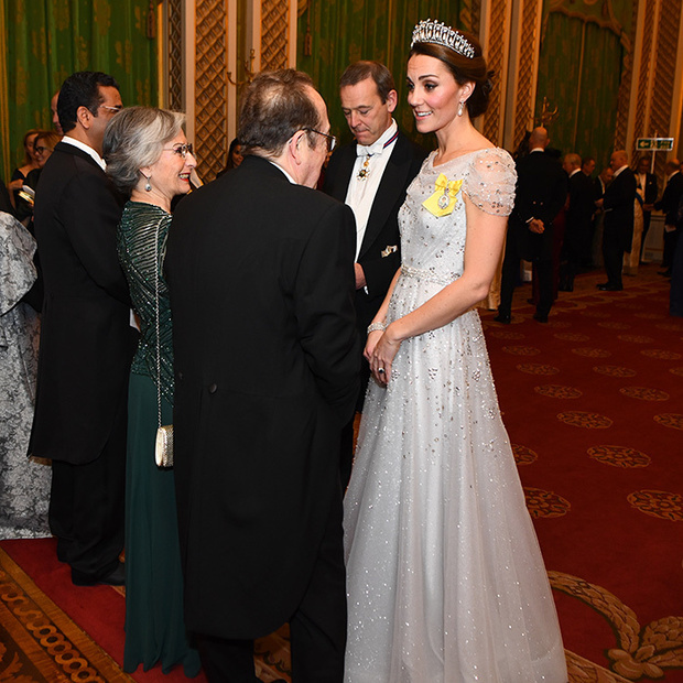 Duchess Kate amped up the glamour in a stunning new Jenny Packham gown, in the faintest of baby blues, and her favourite Cambridge Lover's Knot tiara for the Queen's annual Diplomatic Reception at Buckingham Palace on Dec. 4. The piece de resistance? Her Royal Family Order, which was a gift from that Queen that she's now worn three times. 