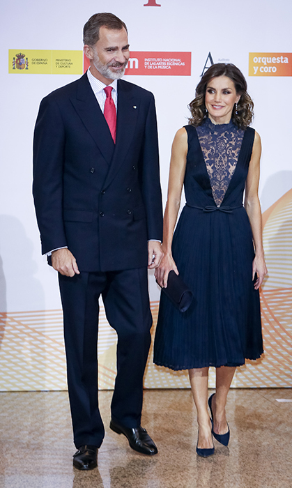 The Spanish queen dazzled in a plunging navy-blue dress with lace neckline, pairing the elegant look with her Nina Ricci suede pumps and a Felipe Varela flap clutch. She stepped out with her husband to commemorate the 40th anniversary of the Spanish Constitution on Dec 5.