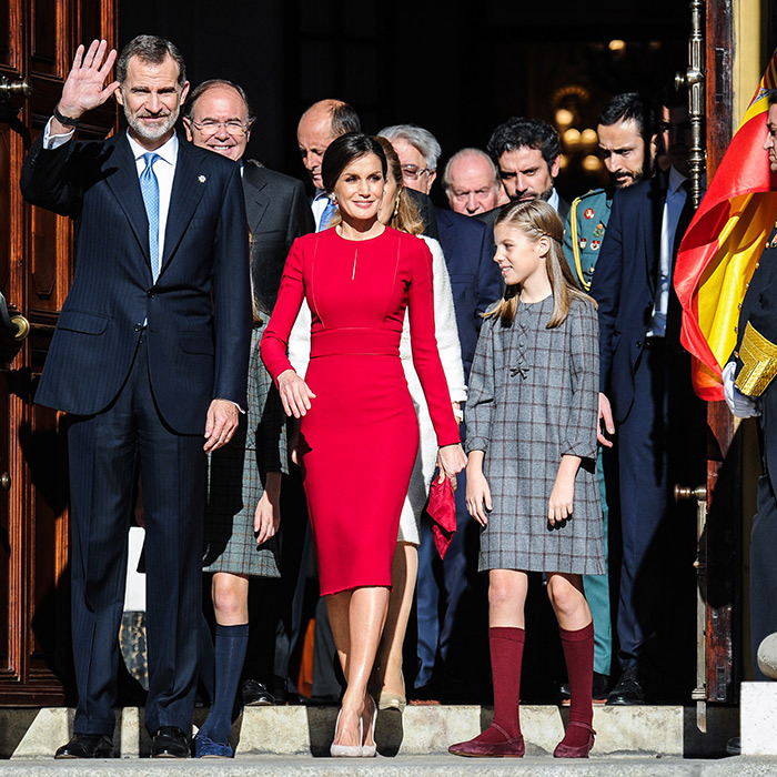 Mother-of-two Queen Letizia looked radiant in a red pencil dress on Dec. 6 to celebrate 40 years of democracy in Spain at the Spanish Congress alongside her family.