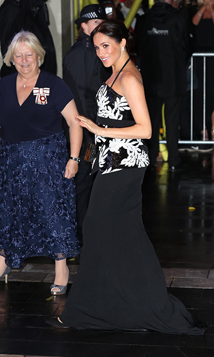 The pregnant royal pulled out all the stops for her first trip to the Royal Variety Performance in November 2018, clad in a stunning <strong><a href=/tags/0/safiyaa>Safiyaa</a></strong> gown. The heavily beaded top boasted a black-and-white floral design with a nipped waist and small peplum, plus a very thin halter strap (a favourite silhouette of her late mother-in-law, <a href=/tags/0/princess-diana><strong>Princess Diana</a></strong>). 