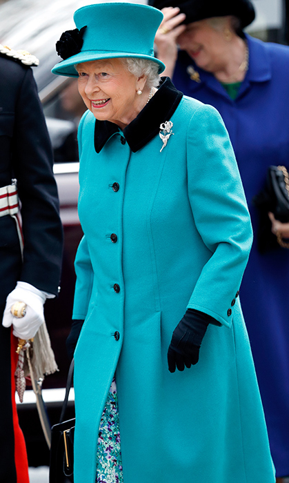 Her Majesty dazzled in a jewel-toned coat, matching hat and pretty patterend dress for the opening of the Queen Elizabeth II centre at Coram on Dec. 5. Coram, the UK's oldest children's charity, was founded by Thomas Coram and granted a Royal Charter in 1739, which established it as The Foundling Hospital, the first home in London to care for abandoned babies and vulnerable children.