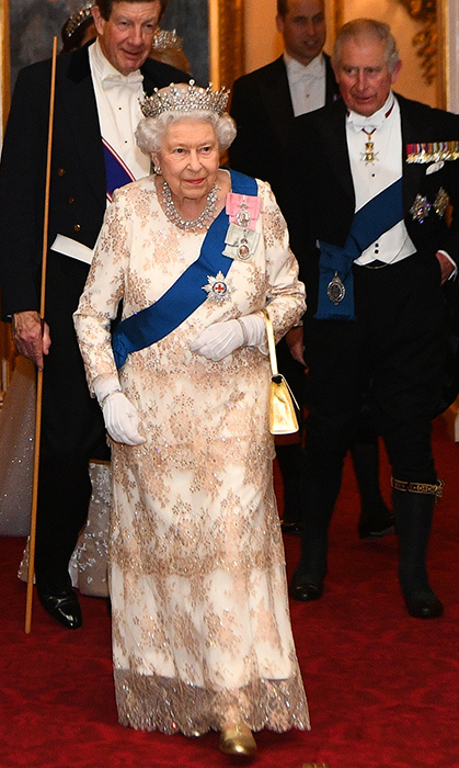 The Queen went all out glamorous for an evening reception for members of the Diplomatic Corps at Buckingham Palace on Dec. 4. She dazzled in a champagne-and-white tiered gown and topped her look off with the Girls of Great Britain and Ireland tiara.