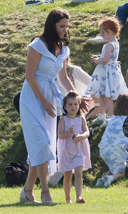 For a fun day out at a polo match, Duchess Kate looked perfectly summery in an affordable Zara dress and wedge heels on June 10.