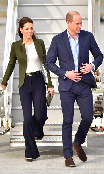 The mother of three wore a rare pair of pants for a visit to RAF Akrotiri in Cyprus in December. She paired it with an olive-green 'Duchess' blazer by Smythe, a simple white top, suede pumps and her L.K. Bennett clutch.