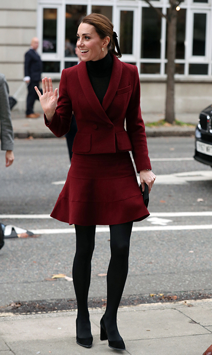 November brought out the best in fall fashion for the duchess, who dazzled in a berry-hued Paule Ka skirt suit, her Tod's suede pumps and a chic ponytail tied with a ribbon. She was making an surprise visit to University College London to learn more about the development of children's brains.