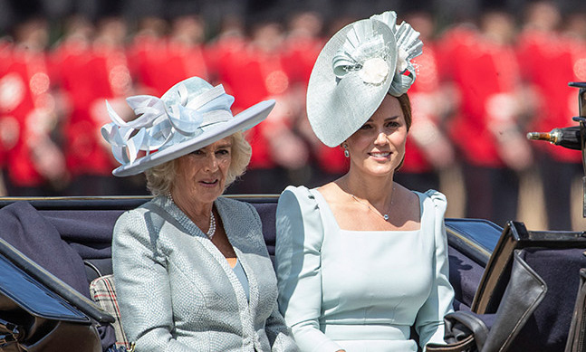 The Duchesses of Cambridge and Cornwall matched in beautiful blues! Kate donned a gorgeous square-neck design by Alexander McQueen with embellished shoulders and topped it off with a large fascinator for the fun celebration.