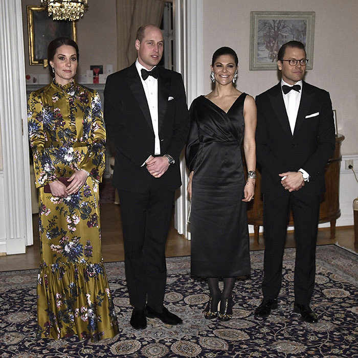Prince William and Kate paid a visit to the Residence of the British Ambassador in Stockholm, where they spent some time chatting before attending a glitzy black-tie dinner. Pregnant Kate wore a stunning floral gown by Canadian-born, London-based designer Erdem, which skimmed her growing baby bump. She accessorized with a clutch and her hair in an updo.