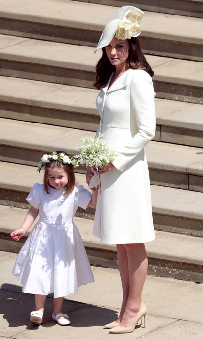 For her most high-profile wedding guest moment to date, at brother-in-law Prince Harry's nuptials to Duchess Meghan in 2018, Kate opted for a familiar silhouette in the palest yellow Alexander McQueen coat dress. Just weeks after she welcomed Prince Louis, the duchess opted for a design very similar to the one she wore to Princess Charlotte's christening. She topped off the look with a floral-embellished Philip Treacy hat.