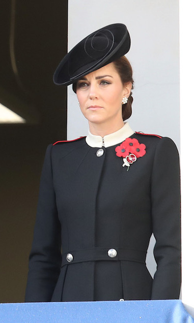For a sombre Remembrance Day ceremony on Nov. 11, Duchess Kate wore a military-style coat by Alexander McQueen, topping her look off with a black fascinator and a trio of poppies.