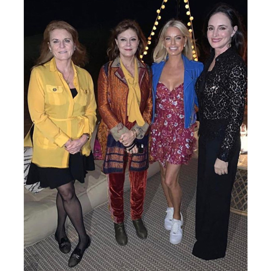 Sarah, Duchess of York's assistant shared this chic shot of the royal with Susan Sarandon and friends in Dubai. Princess Beatrice and Princess Eugenie's mom wore a sheer yellow blouse, belted at the waist, over a black dress with stockings and loafers. 