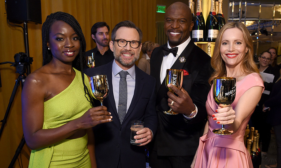 <em>Black Panther</em>'s Danai Gurira, and actors Christian Slater, Terry Crews and Leslie Mann cheers'd each other at the Moet & Chandon 76th Annual Golden Globe Awards Nominations party on Dec. 6.