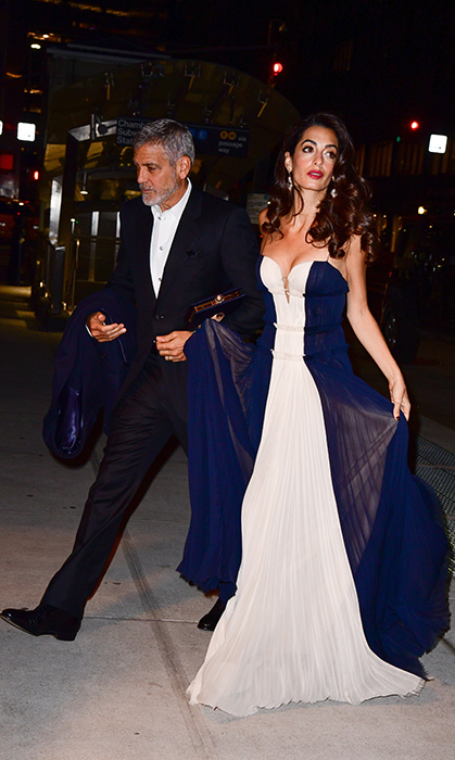 Amal and George Clooney can do no wrong when it comes to date night style! The two were spotted on the streets of Manhattan, arriving at Cipriani, on Dec. 5.