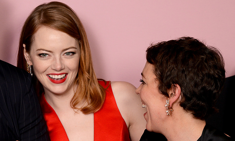 Emma Stone and Olivia Colman got a case of the giggles while stopping for photos in the winners room at the 21st British Independent Film Awards on Dec. 2. The talented duo co-star in the upcoming royal film <em>The Favourite</em>.