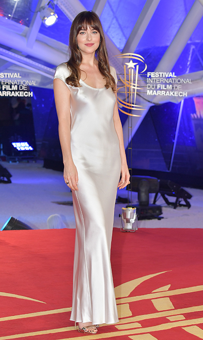Va va voom! Dakota Johnson stunned in silver at the 17th Marrakech International Film Festival on Dec. 2.