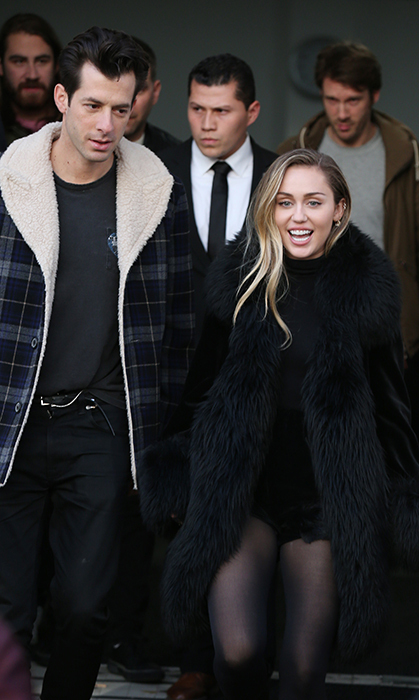 Mark Ronson and Miley Cyrus left the BBC Maida Vale Radio Studios on Dec 7 in London, England. The two matched in all-black outfits, and naturally Miley stopped to take some selfies with fans.