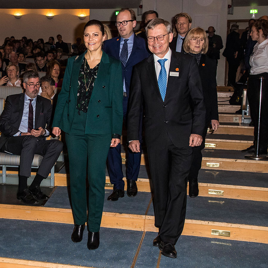 Crown Princess Victoria of Sweden looked chic in a green double-breasted suit while attending the Nobel Week 'Water Matters' event in Stockholm on Dec. 9 alongside Nobel Foundation chairman Carl-Henrik Heldin. 