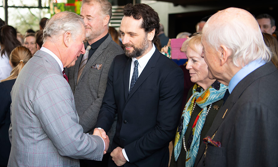 Prince Charles met Welsh actors Owen Teale and <em>The Americans</em> star Matthew Rhys while in Cardiff on an official visit to the Royal Welsh College of Music and Drama on Dec. 7. The future King has been a patron of the college for decades.