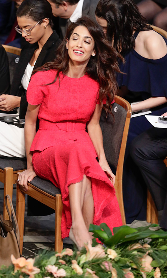 Amal Clooney was on hand at the Nobel Prize Awards Ceremony in Stockholm, where Sweden's Royal Family was out in full swing - tiaras and all! The barrister wore a punchy pink ensemble that paired a skirt with a frayed hemline a short-sleeved, peplum jacket with a belted waist. 