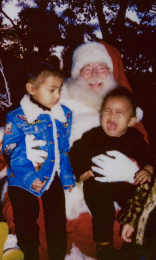 Kim Kardashian treated fans to this snap of Saint West's first visit with smiling Santa. North West looked thoroughly puzzled as her little brother wailed.