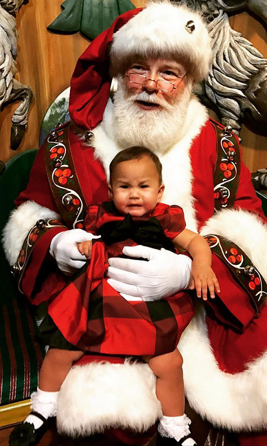Luna's got little brother Miles to teach about Santa this year, but on her first visit to jolly Saint Nick in 2016 she wasn't so sure! Clad in the sweetest red plaid dress, white socks and patent party shoes, Chrissy Teigen and John Legend's little one couldn't help but cry. 