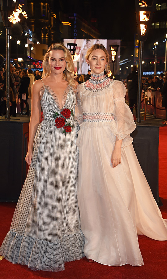Margot Robbie and Saoirse Ronan were anything but enemies as they debuted their latest, <em>Mary, Queen of Scots</em>, in London on Dec. 10. Margot stunned in a polka-dot Rodarte design with floral appliques, while Saoirse opted for a Carolina Herrera gown with a Victorian neckline and sheer billowy sleeves. The blonde beauties take on feuding monarchs Queen Elizabeth I and Mary in the new drama, which hits theatres on Dec. 14. 
