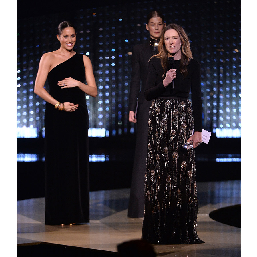 "Clare accepted her award as the Duchess of Sussex looked on smiling and cradling her blossoming bump. ""I got to know Meghan on such a personal level,"" the Givenchy artistic director said. ""To have someone like that trust you in an incredible moment in their life is something that is just the most unbelievable honor. I can't thank you enough because it was the most beautiful moment.""