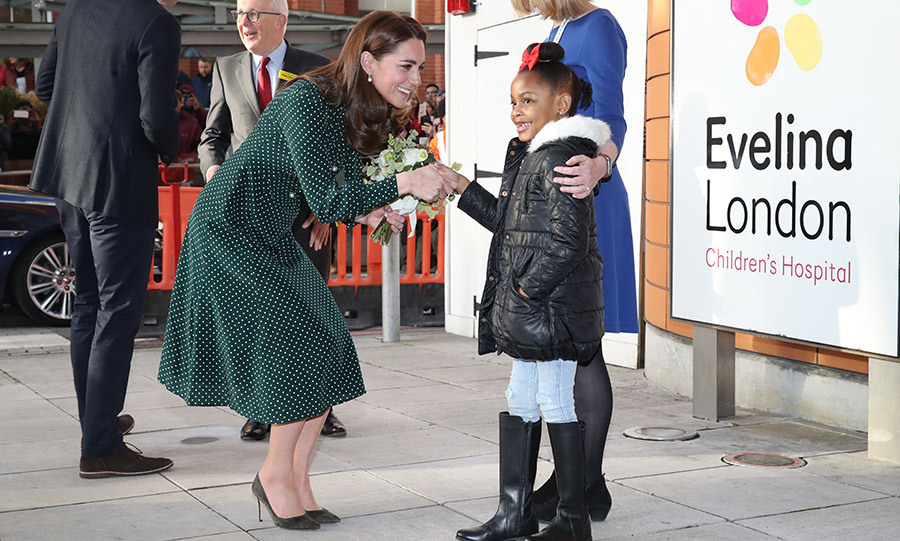 A sweet young girl gave the duchess a bouquet when she arrived with Prince William.